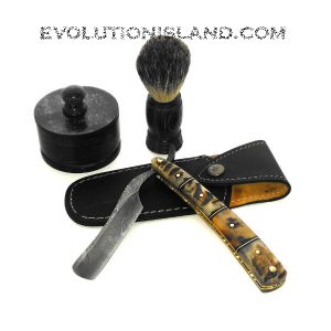 A Damascus Steel Straight Razor with Rams Horn handle Shaving Set